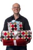 Ο καυκάσιος τύπος δίνει ένα δώρο που απομονώνεται στο λευκό στοκ εικόνα με δικαίωμα ελεύθερης χρήσης