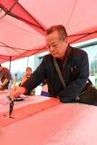 Ο καλλιγράφος xie γράφει couplets φεστιβάλ άνοιξη Στοκ εικόνες με δικαίωμα ελεύθερης χρήσης