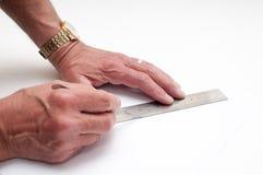Ο καλλιτέχνης επανδρώνει την κοπή χεριών με ένα χειρουργικό νυστέρι Στοκ Φωτογραφίες