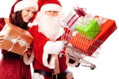 Ο κ. και κα Άγιος Βασίλης που ψωνίζουν για τα δώρα στοκ εικόνες