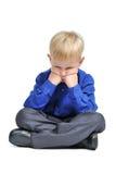 ο λωτός αγοριών θέτει το λυπημένο κοστούμι συνεδρίασης στοκ φωτογραφίες