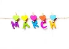 Ο μήνας Μαρτίου των χρωματισμένων επιστολών στοκ εικόνα