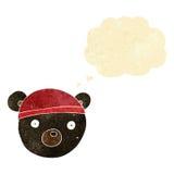 ο Μαύρος κινούμενων σχεδίων αντέχει cub φορώντας το καπέλο με τη σκεπτόμενη φυσαλίδα Στοκ φωτογραφία με δικαίωμα ελεύθερης χρήσης