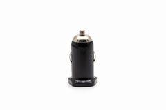 Ο μαύρος φορτιστής αυτοκινήτων USB στο λευκό Στοκ φωτογραφίες με δικαίωμα ελεύθερης χρήσης