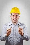 Ο 0 μηχανικός σπάζει ένα μολύβι με τα χέρια του Στοκ Εικόνες
