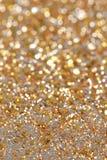 Ο νέοι χρυσός και το ασήμι έτους Χριστουγέννων ακτινοβολούν υπόβαθρο Αφηρημένη σύσταση διακοπών Στοκ Εικόνες