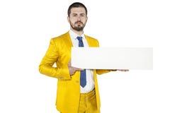 Ο νέος επιχειρηματίας κρατά στα χέρια του μια θέση στη διαφήμισή σας Στοκ Εικόνες