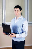 Ο νέος επιχειρηματίας στο γραφείο Στοκ φωτογραφία με δικαίωμα ελεύθερης χρήσης
