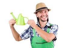 Ο νέος εύθυμος κηπουρός με το πότισμα μπορεί Στοκ Εικόνα