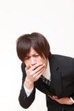 Ο νέος ιαπωνικός επιχειρηματίας αισθάνεται όπως τον εμετό Στοκ Εικόνες