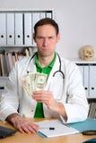 Ο νέος οικογενειακός γιατρός με τα δολάρια είναι 0 Στοκ φωτογραφία με δικαίωμα ελεύθερης χρήσης