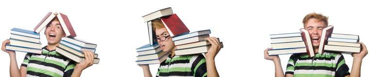 Ο νέος σπουδαστής με τα βιβλία που απομονώνεται στο λευκό στοκ φωτογραφία