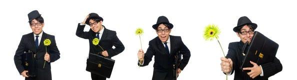 Ο νεαρός άνδρας κοστούμι με το λουλούδι που απομονώνεται στο μαύρο στο λευκό στοκ εικόνες με δικαίωμα ελεύθερης χρήσης