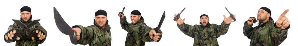 Ο νεαρός άνδρας στο ομοιόμορφο μαχαίρι εκμετάλλευσης στρατιωτών στο λευκό Στοκ φωτογραφίες με δικαίωμα ελεύθερης χρήσης