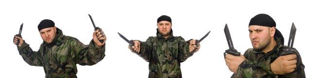 Ο νεαρός άνδρας στο ομοιόμορφο μαχαίρι εκμετάλλευσης στρατιωτών Στοκ εικόνα με δικαίωμα ελεύθερης χρήσης