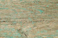 Ο ξύλινος πίνακας, χρωμάτισε στο πράσινο χρώμα με ραγισμένος και αποφλοίωση PA Στοκ Εικόνες