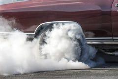 Ο οπίσθιος καπνός ροδών παρουσιάζει Στοκ Εικόνα