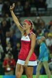 Ο ολυμπιακός πρωτοπόρος Μόνικα Puig του Πουέρτο Ρίκο γιορτάζει τη νίκη αφότου ξεχωρίζουν οι γυναίκες ` s αντισφαίρισης τελικό του Στοκ Φωτογραφία