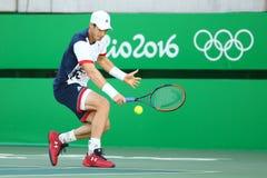 Ο ολυμπιακός πρωτοπόρος Andy Murray της Μεγάλης Βρετανίας στη δράση κατά τη διάρκεια των ατόμων ` s ξεχωρίζει Στοκ φωτογραφίες με δικαίωμα ελεύθερης χρήσης