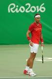 Ο ολυμπιακός πρωτοπόρος Rafael Nadal της Ισπανίας στη δράση κατά τη διάρκεια των ατόμων ` s ξεχωρίζει την πρώτη στρογγυλή αντιστο Στοκ Φωτογραφίες