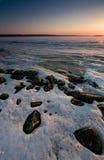 Ο πάγος ποταμών στο φως ηλιοβασιλέματος Στοκ Εικόνα