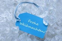 Ο πάγος Frohe Weihnachten ετικετών σημαίνει τη Χαρούμενα Χριστούγεννα στοκ φωτογραφίες