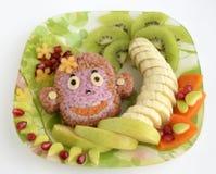 Ο πίθηκος αποτελείται από το ρύζι στοκ φωτογραφίες