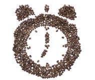 Ο πίνακας του ρολογιού τα κουδούνια που ενθέτονται με με το ψημένο φασόλι καφέ Στοκ Εικόνες