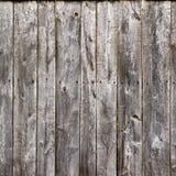 Ο παλαιός γκρίζος φράκτης επιβιβάζεται στην ξύλινη σύσταση Στοκ Εικόνα