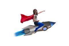 Ο πετώντας πύραυλος μικρών κοριτσιών στην έννοια superhero Στοκ Φωτογραφία
