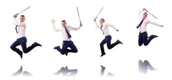 Ο πηδώντας επιχειρηματίας με το ρόπαλο του μπέιζμπολ Στοκ Εικόνες