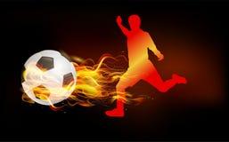 Ο ποδοσφαιριστής κλώτσησε τη σφαίρα πυρκαγιάς Στοκ φωτογραφίες με δικαίωμα ελεύθερης χρήσης