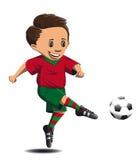 Ο ποδοσφαιριστής χτυπά το πόδι στη σφαίρα Στοκ Φωτογραφία