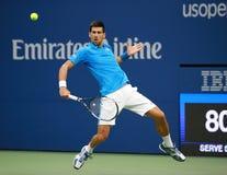 Ο πρωτοπόρος Novak Djokovic του Grand Slam της Σερβίας στη δράση κατά τη διάρκεια του τελικού αγώνα του στις ΗΠΑ ανοίγει το 2016 Στοκ φωτογραφία με δικαίωμα ελεύθερης χρήσης