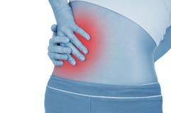 Ο δριμύς πόνος στα νεφρά, που παρουσιάζονται κόκκινο, κρατά στοκ φωτογραφία