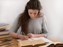 Ο σπουδαστής κάνει τις σημειώσεις Στοκ Φωτογραφίες