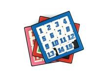 Ο σωρός του ζωηρόχρωμου παιχνιδιού τσεπών που γλιστρά 15 αριθμούς μπερδεύει το παιχνίδι που απομονώνεται στο άσπρο υπόβαθρο Στοκ εικόνες με δικαίωμα ελεύθερης χρήσης