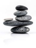 Ο σωρός Stones spa της σκηνής επεξεργασίας zen όπως τις έννοιες 13 όντας χτισμένη πόρτα τα δωρικά βγαίνοντας ελληνικά Δεκεμβρίου  Στοκ Φωτογραφία
