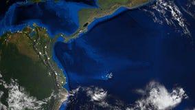 ο τρισδιάστατος πλανήτης Γη με μερικά σύννεφα, διαφορετικές ήπειροι, υπολογιστής που παράγεται δίνει το υπόβαθρο ελεύθερη απεικόνιση δικαιώματος