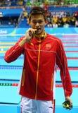 Ολυμπιακός ήλιος Yang πρωτοπόρων της Κίνας κατά τη διάρκεια της τελετής μεταλλίων μετά από την ελεύθερη κολύμβηση ατόμων ` s 200m Στοκ εικόνες με δικαίωμα ελεύθερης χρήσης