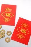 Ο φάκελος των ΕΔ κάλεσε το ANG Pao και τα χρυσά νομίσματα στην κινεζική νέα έννοια έτους Στοκ Εικόνες