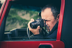 Ο φωτογράφος παίρνει τη φωτογραφία Στοκ Εικόνες