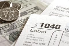 Ο φόρος διαμορφώνει 1040 για το IRS Στοκ εικόνες με δικαίωμα ελεύθερης χρήσης