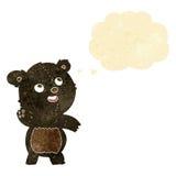 ο χαριτωμένος κυματίζοντας Μαύρος κινούμενων σχεδίων αντέχει teddy με τη σκεπτόμενη φυσαλίδα Στοκ εικόνες με δικαίωμα ελεύθερης χρήσης