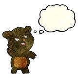 ο χαριτωμένος κυματίζοντας Μαύρος κινούμενων σχεδίων αντέχει teddy με τη σκεπτόμενη φυσαλίδα Στοκ εικόνα με δικαίωμα ελεύθερης χρήσης