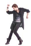 Ο χορευτής με τα χέρια έκαμψε επάνω & κάτω Στοκ Φωτογραφίες