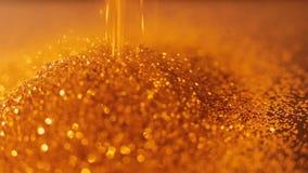 Ο χρυσός ακτινοβολεί λαμπρός αστράφτει bokeh ντεκόρ φιλμ μικρού μήκους