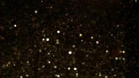 Ο χρυσός ακτινοβολεί σπινθηρίσματα απόθεμα βίντεο