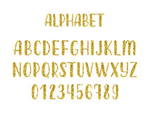 Ο χρυσός ακτινοβολεί συρμένο χέρι λατινικό σύγχρονο αλφάβητο βουρτσών καλλιγραφίας των κεφαλαίων γραμμάτων διάνυσμα Στοκ Εικόνες