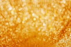 Ο χρυσός ακτινοβολεί το υπόβαθρο για το μέρος Χριστουγέννων ή γάμου Στοκ Φωτογραφίες